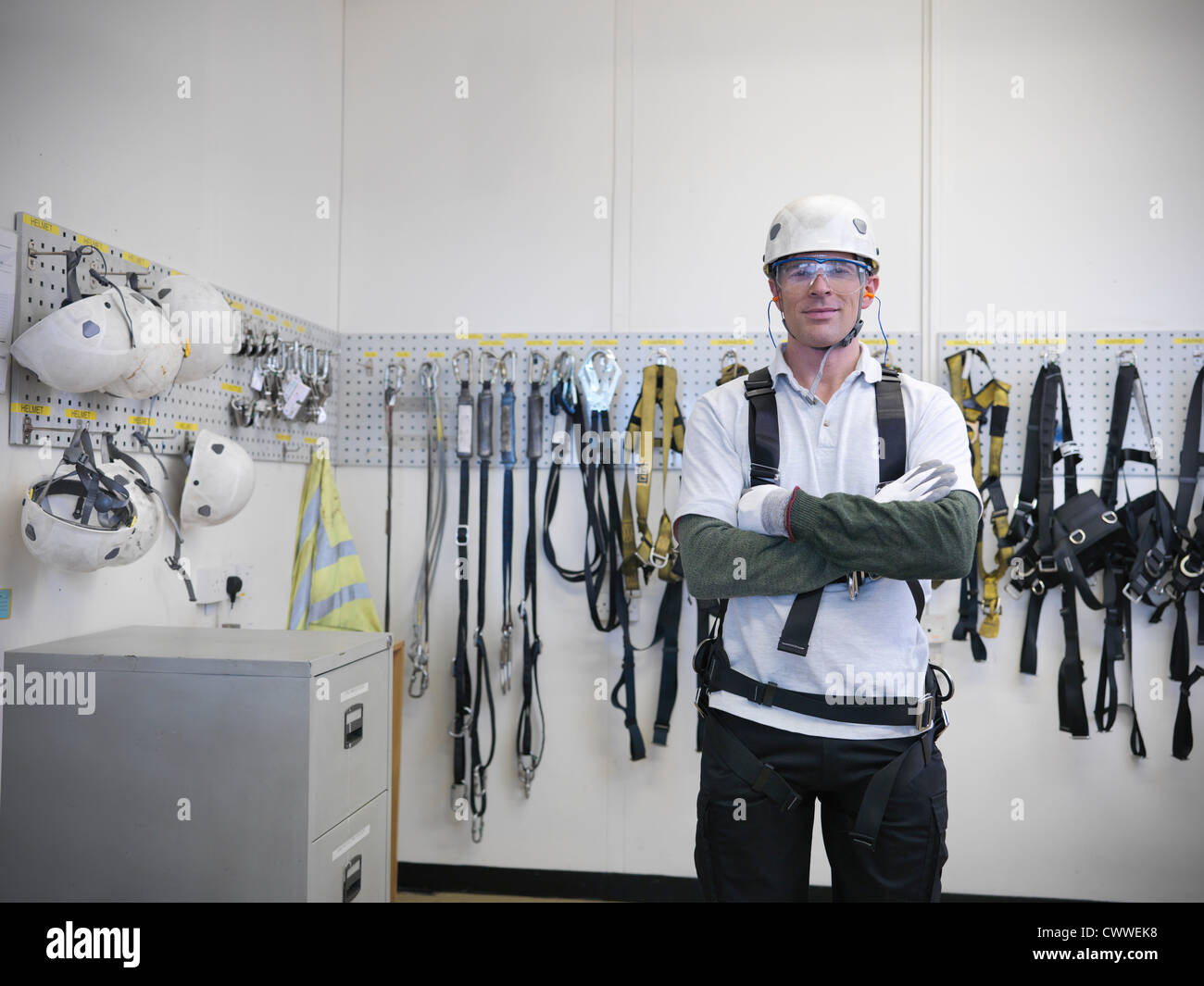 Portrait of car worker wearing health and safety equipment in car factory - Stock Image