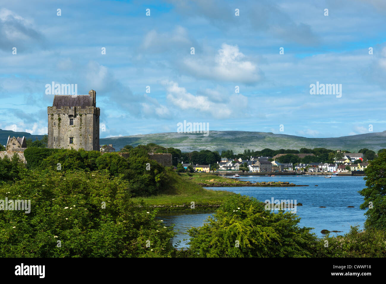 Dunguaire Castle with Kinvara village, County Galway, Ireland. - Stock Image
