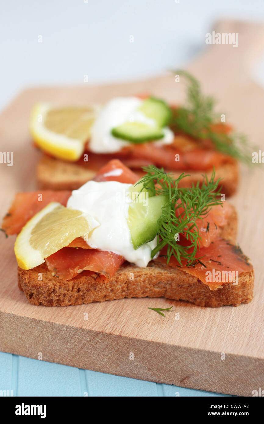 Canapes with smoked salmon and salad - Stock Image