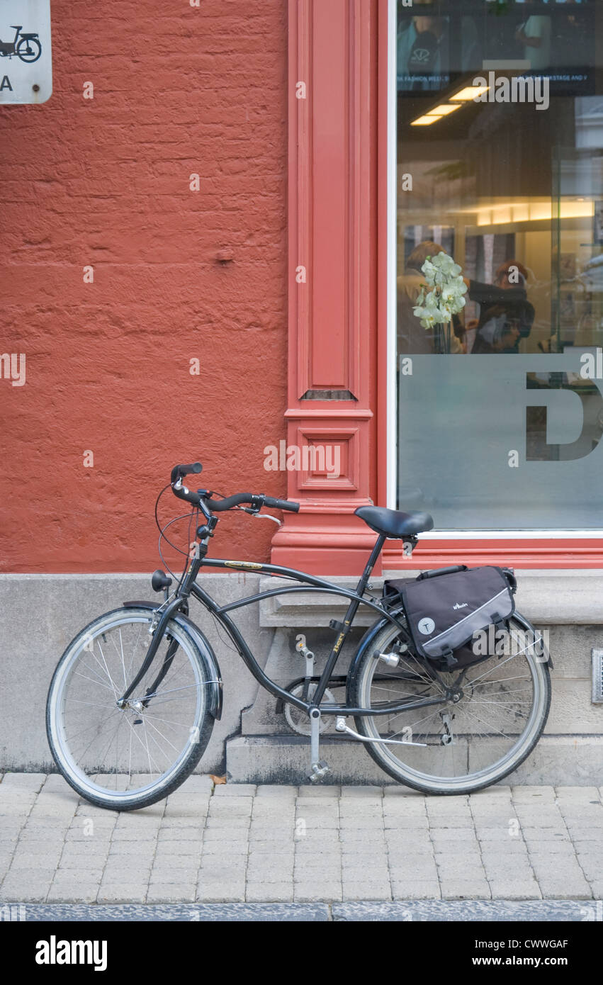 A bicycle leans against a wall in Bruges, Belgium Stock Photo