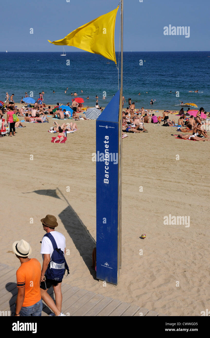 Barcelona beach  yellow flag indicates that precaution to swimmers - Stock Image