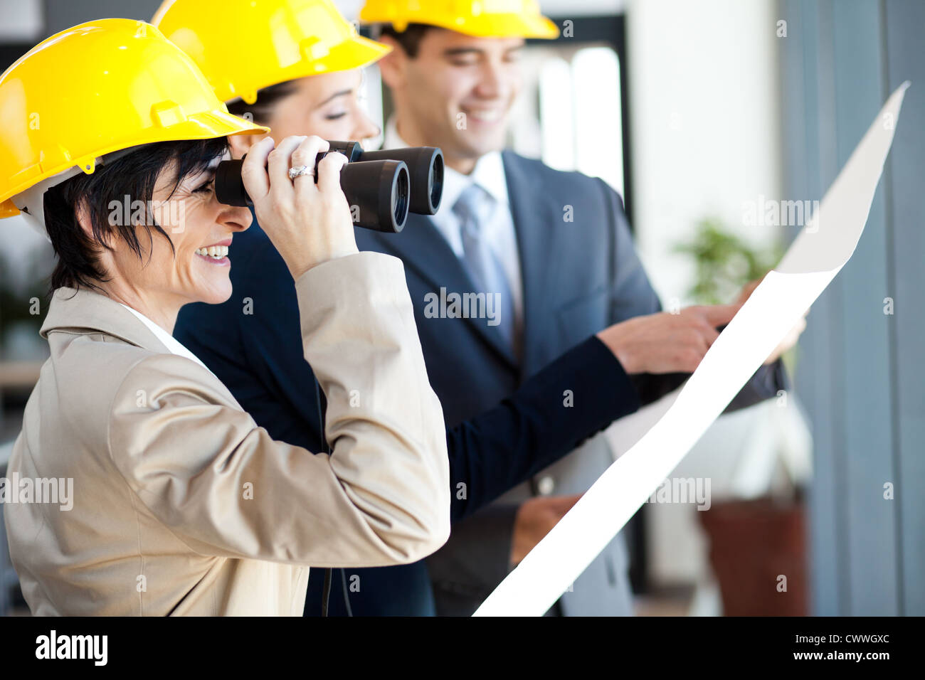 project manager looking at construction site with binoculars - Stock Image