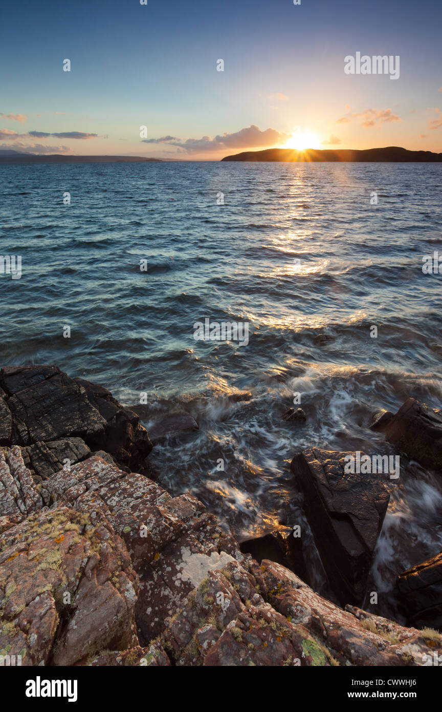 The sun sets behind Horse Island near the Summer Isles, North West Highlands of Scotland. Stock Photo