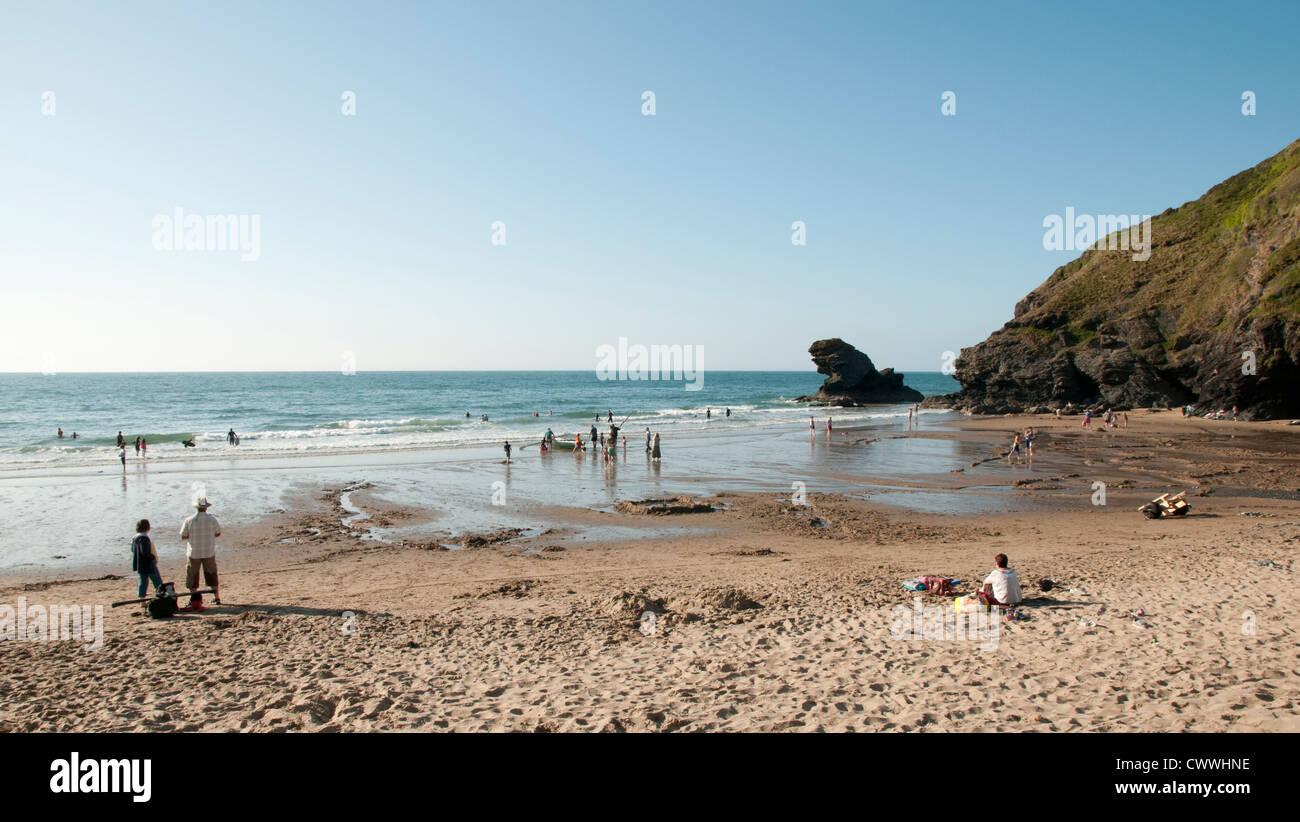 People enjoying the sun at Llangrannog Beach, Ceredigion - Stock Image