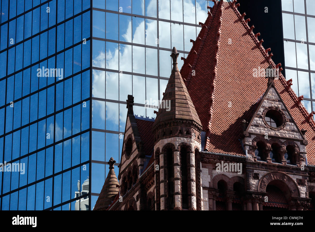 Trinity Church and reflective glass of the Hancock Tower in Boston, Massachusetts - Stock Image