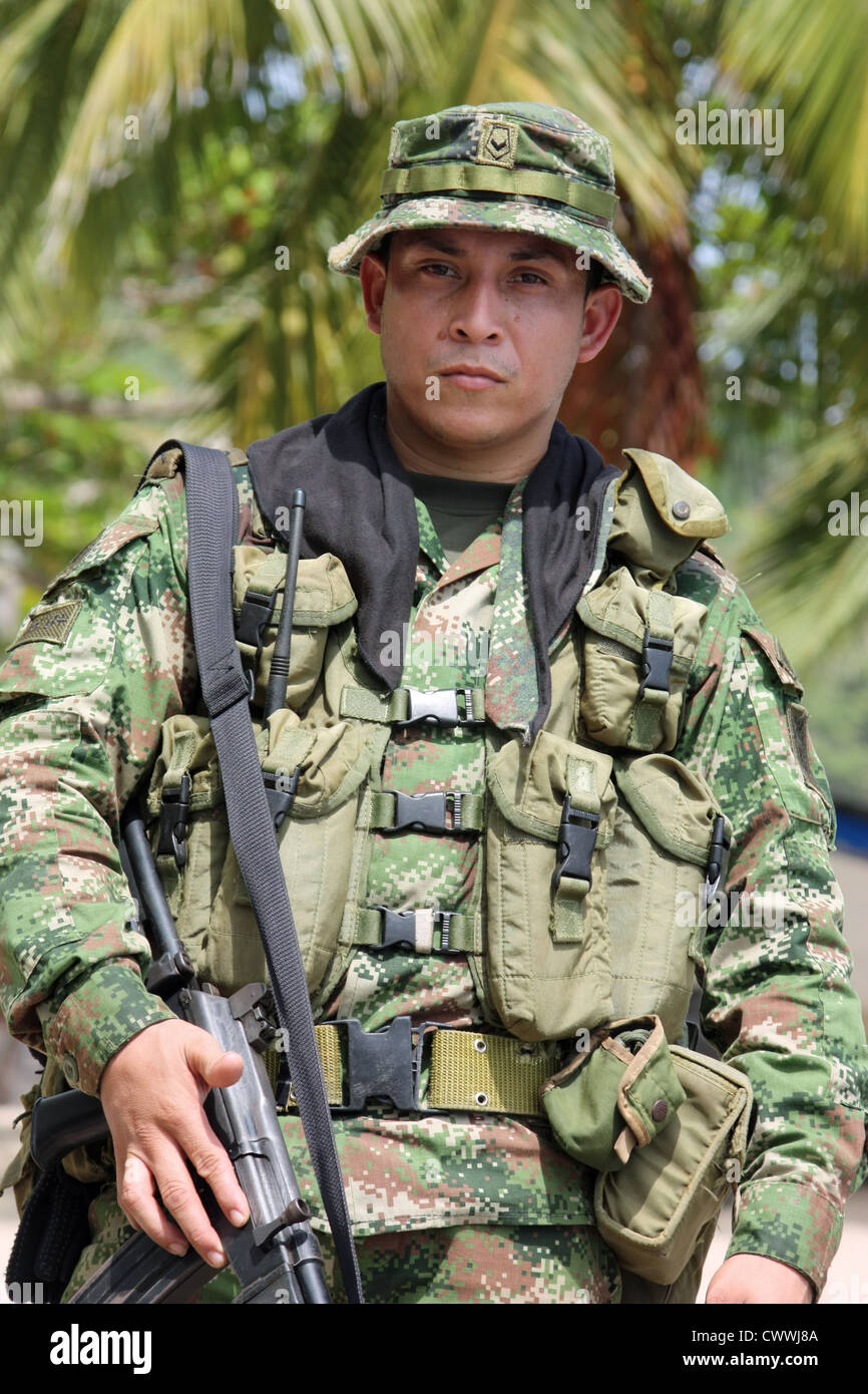 Heavily armed  Colombian soldier on security duty in the The Darien Gap on the Colombia Panama border region, Colombia - Stock Image