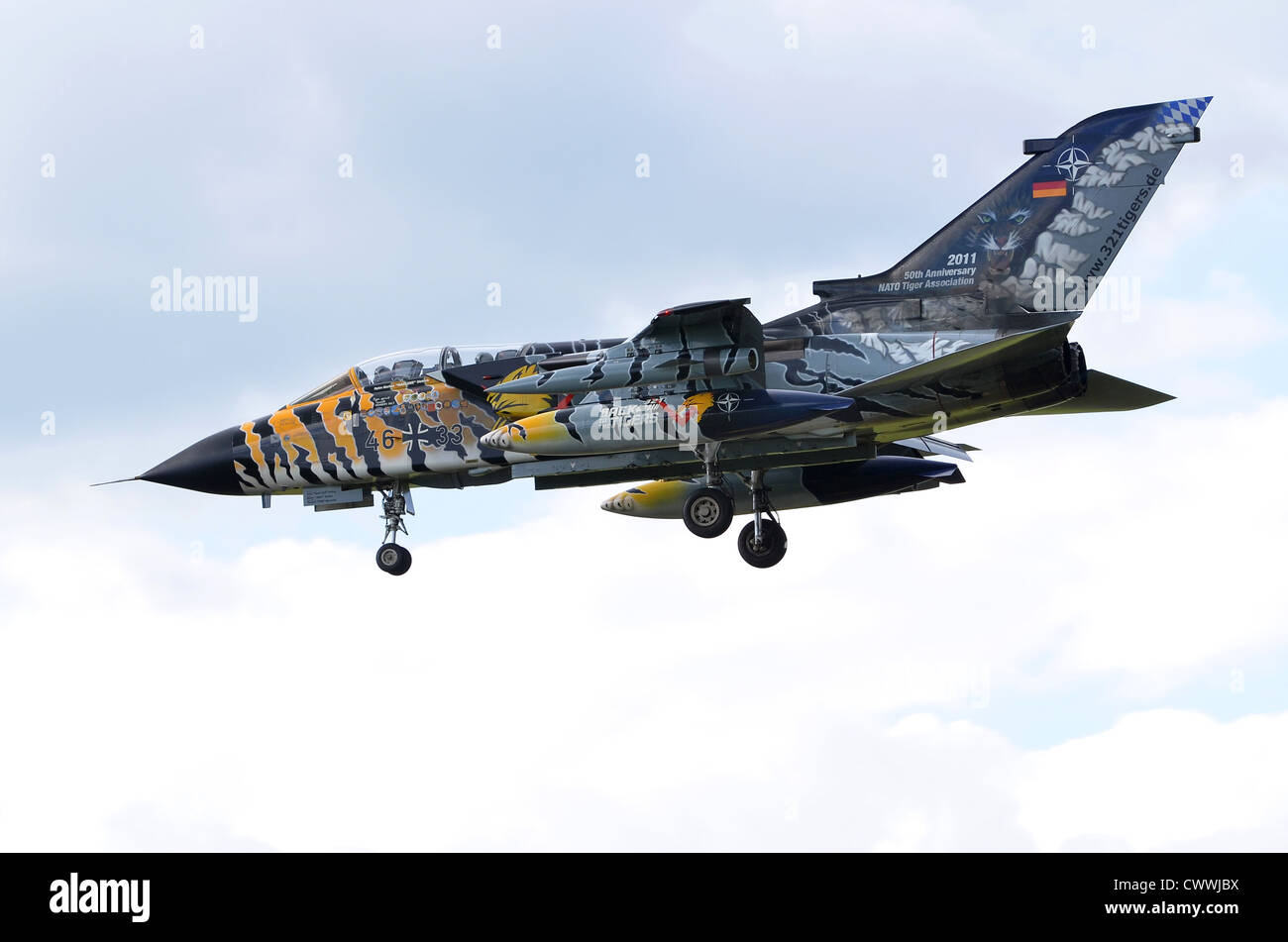 Tornado ECR in Tiger Meet markings operated by the German Air Force on approach for landing at RAF Fairford - Stock Image