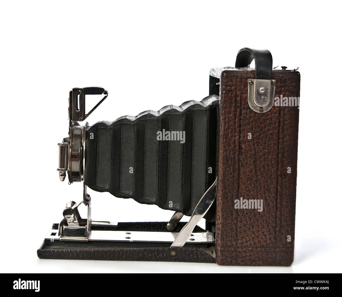 Vintage Folding bellows camera, brown with black bellows, side view. - Stock Image