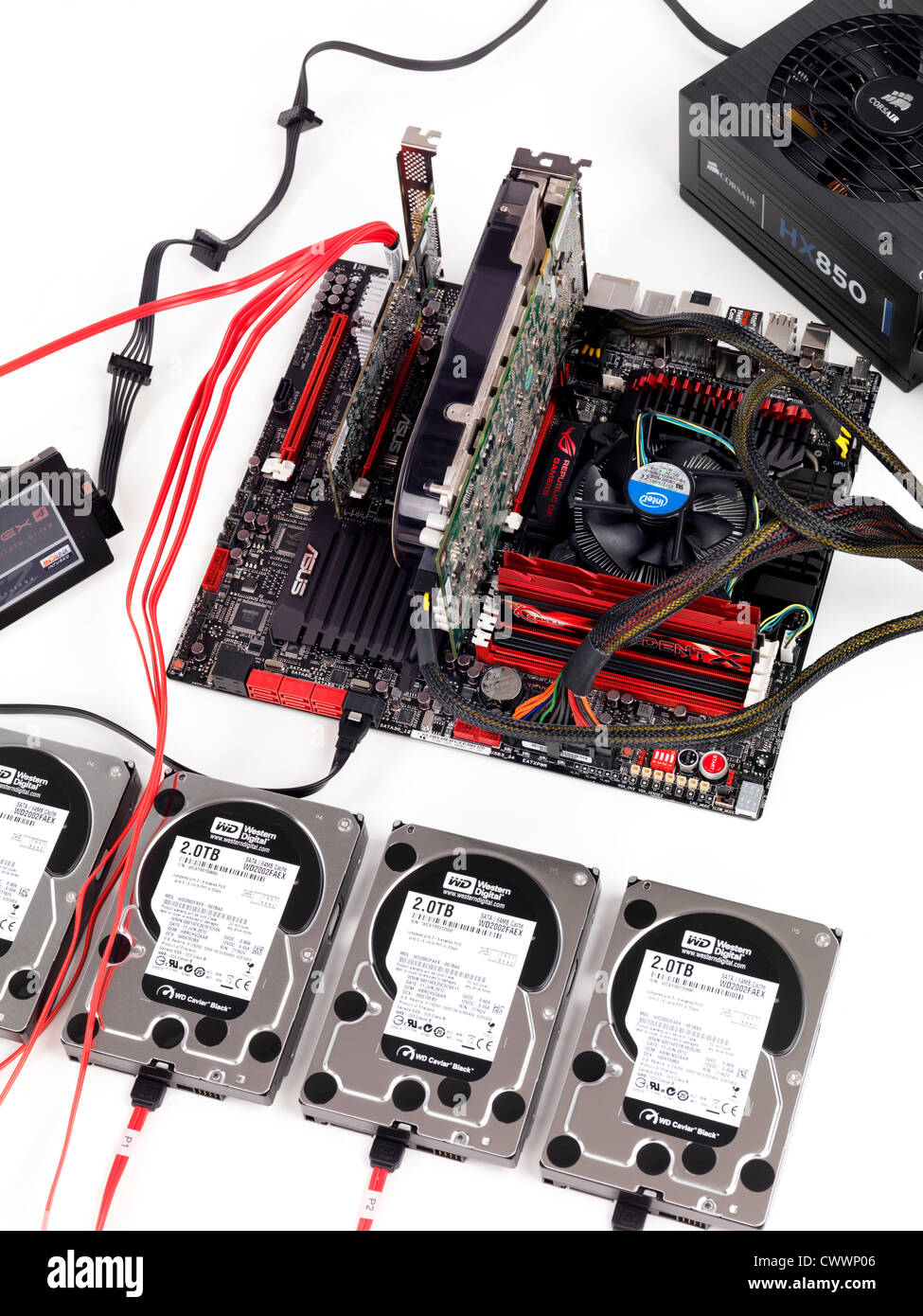 Computer motherboard with four hard drives connected to a RAID controller - Stock Image