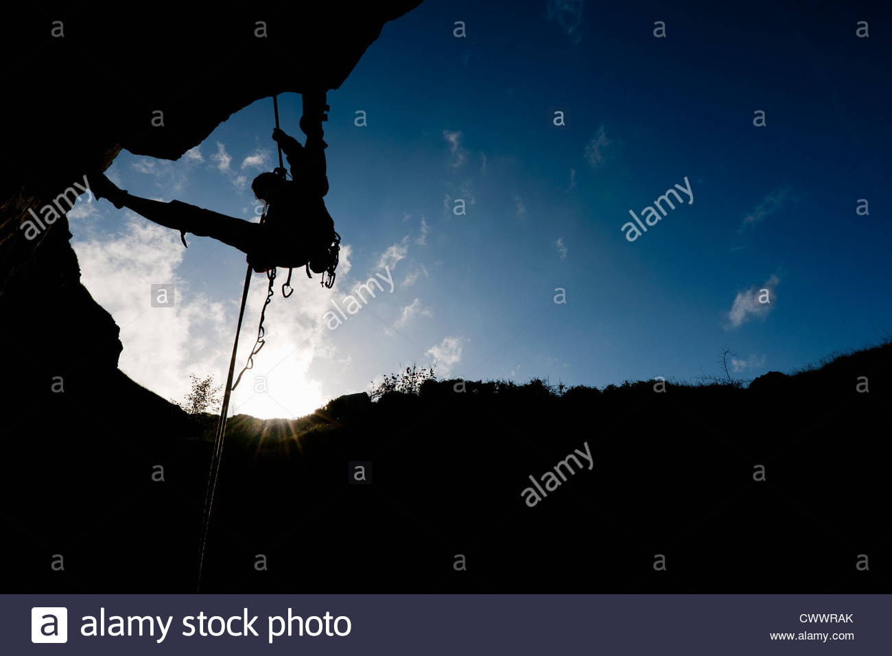 Climber scaling rock face - Stock Image