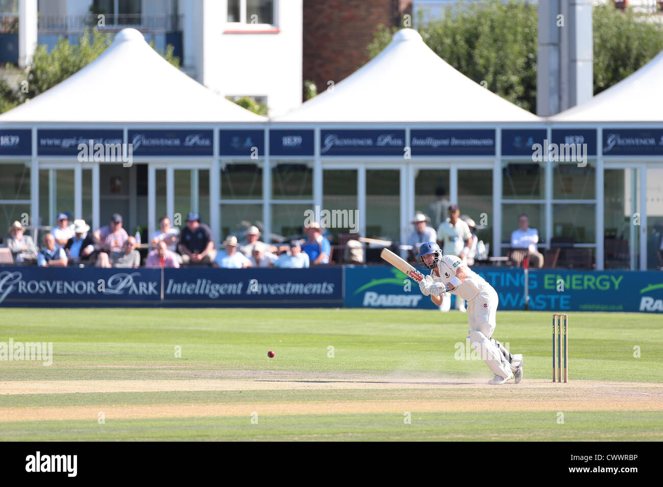 Batsman playing a shot at the County Ground in Hove. - Stock Image