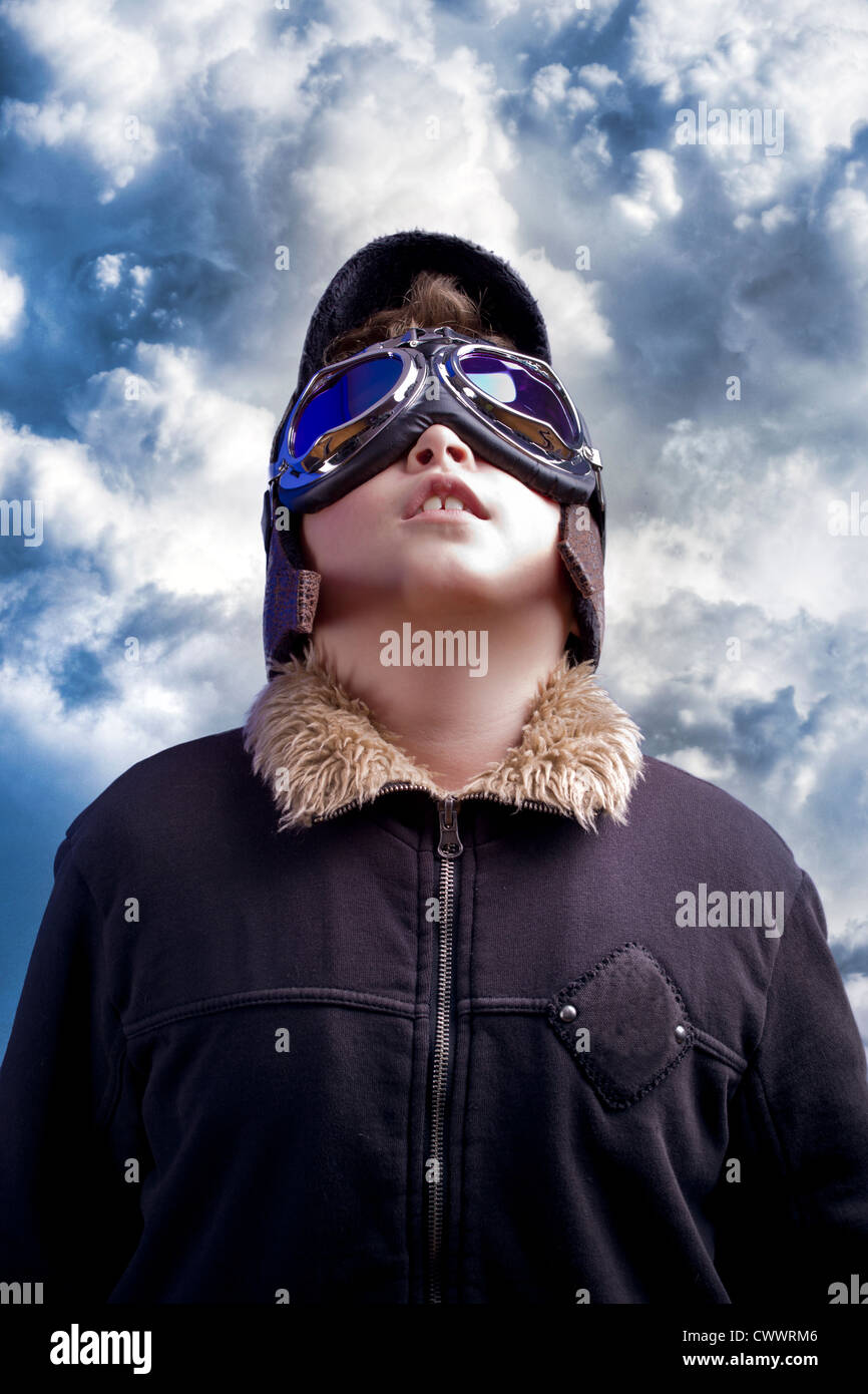 A little boy dreams of becoming a professional pilot. Vintage aviation hat. Stock Photo