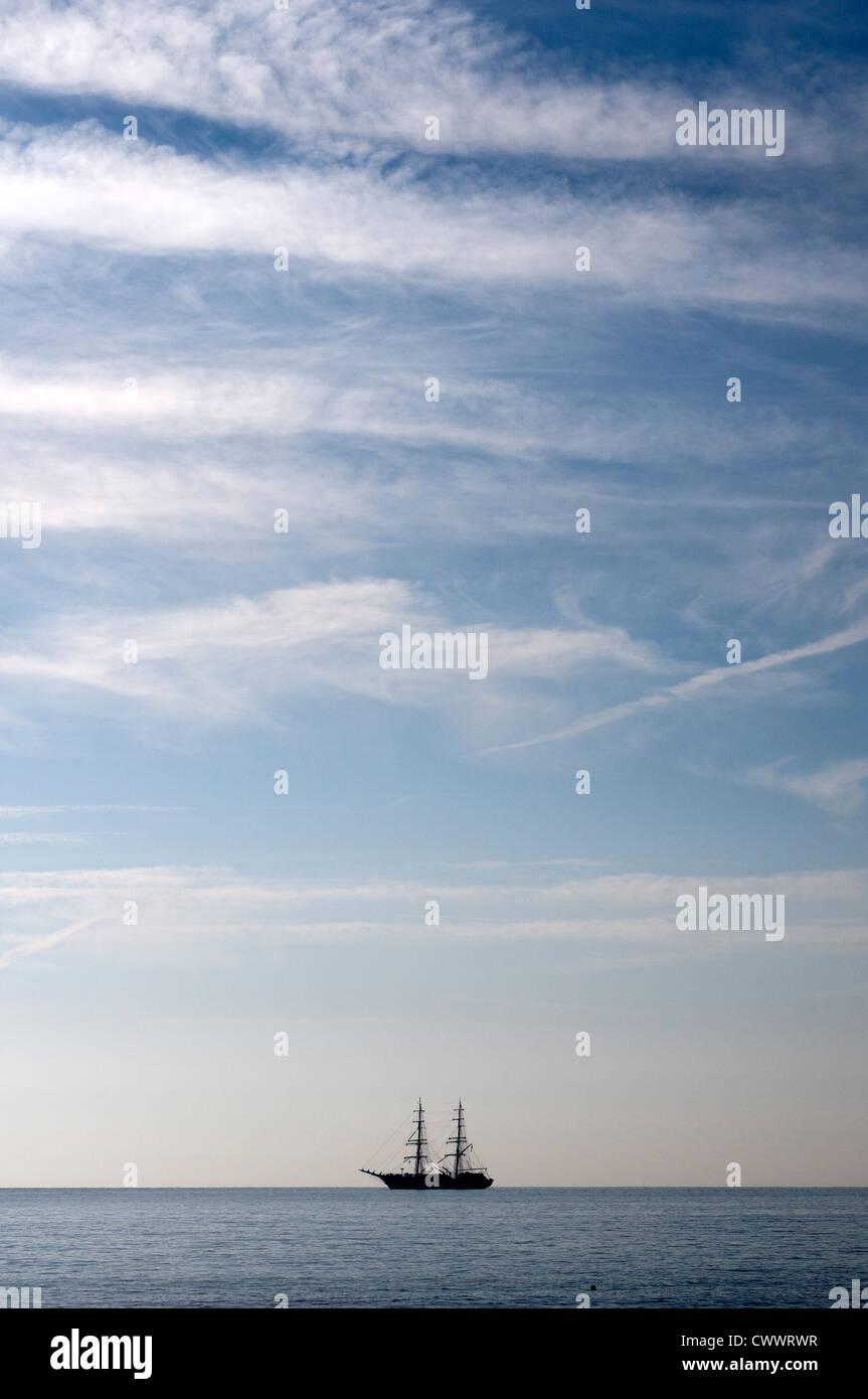 Two masted schooner in Torbay.Devon,blue, boat, boatman, captain, clouds, coast,Horizon,Berry Head - Stock Image