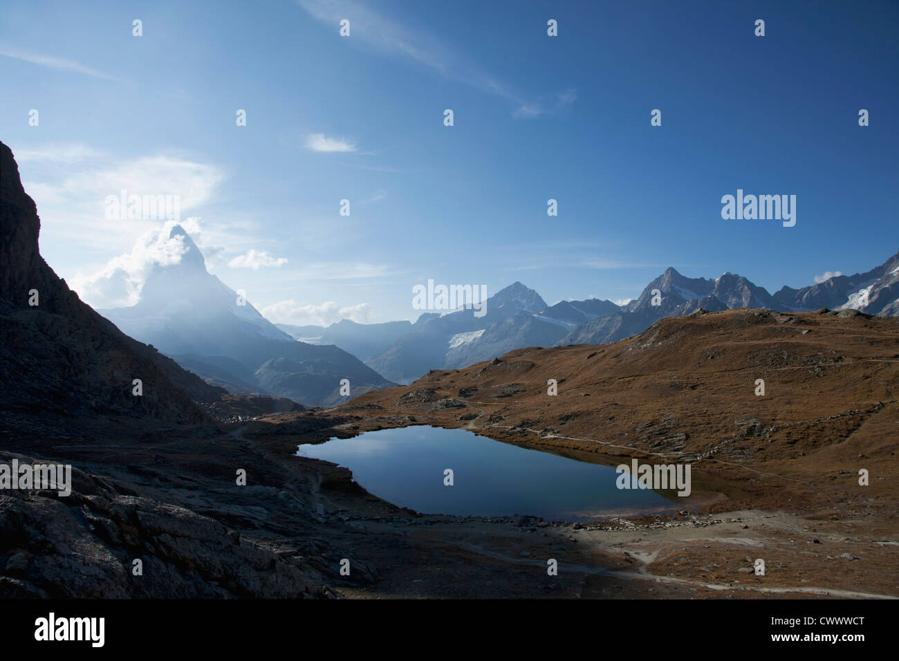 Aerial view of still lake in mountains - Stock Image