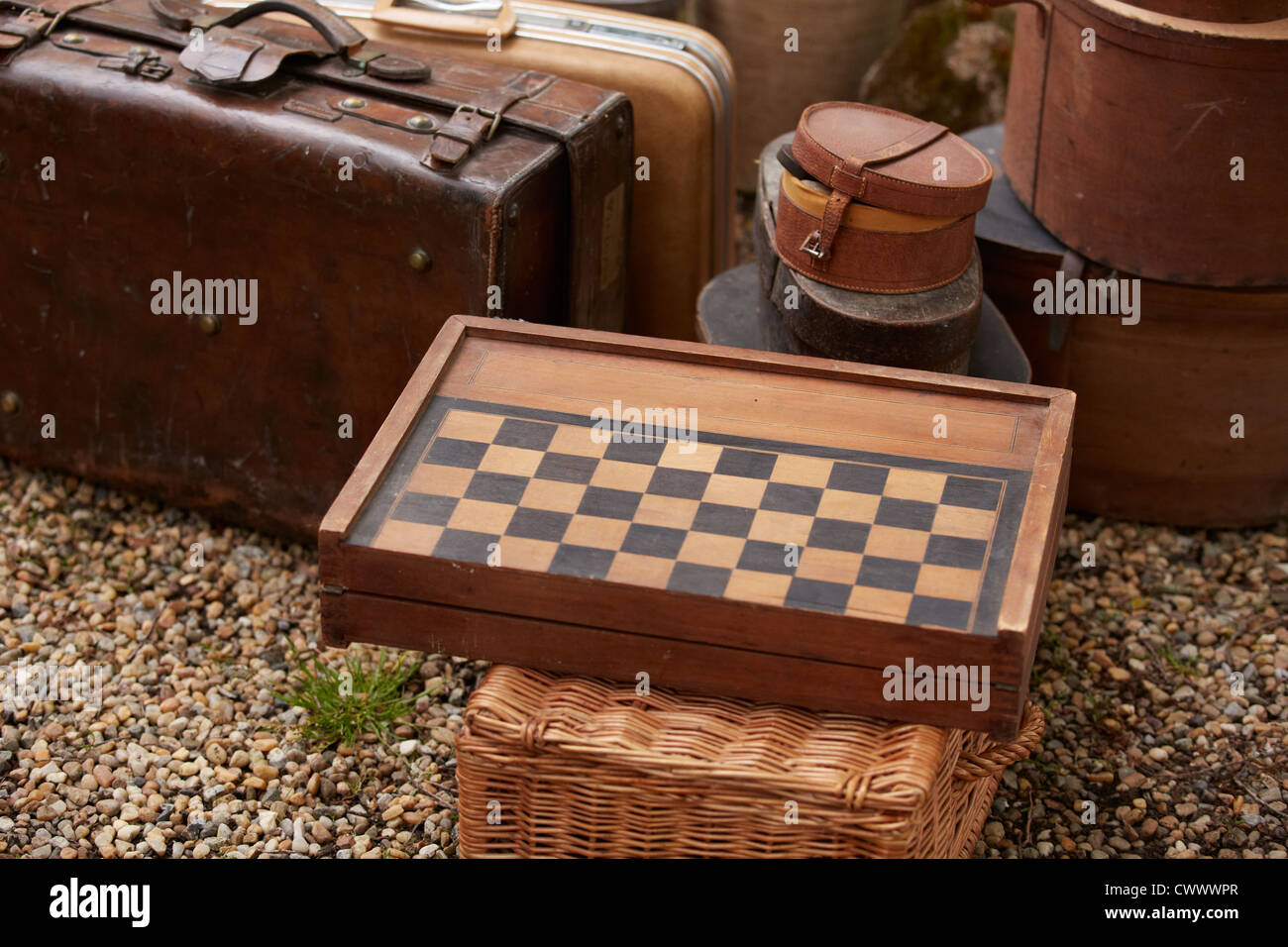 Wooden checkers board with luggage boxed Stock Photo