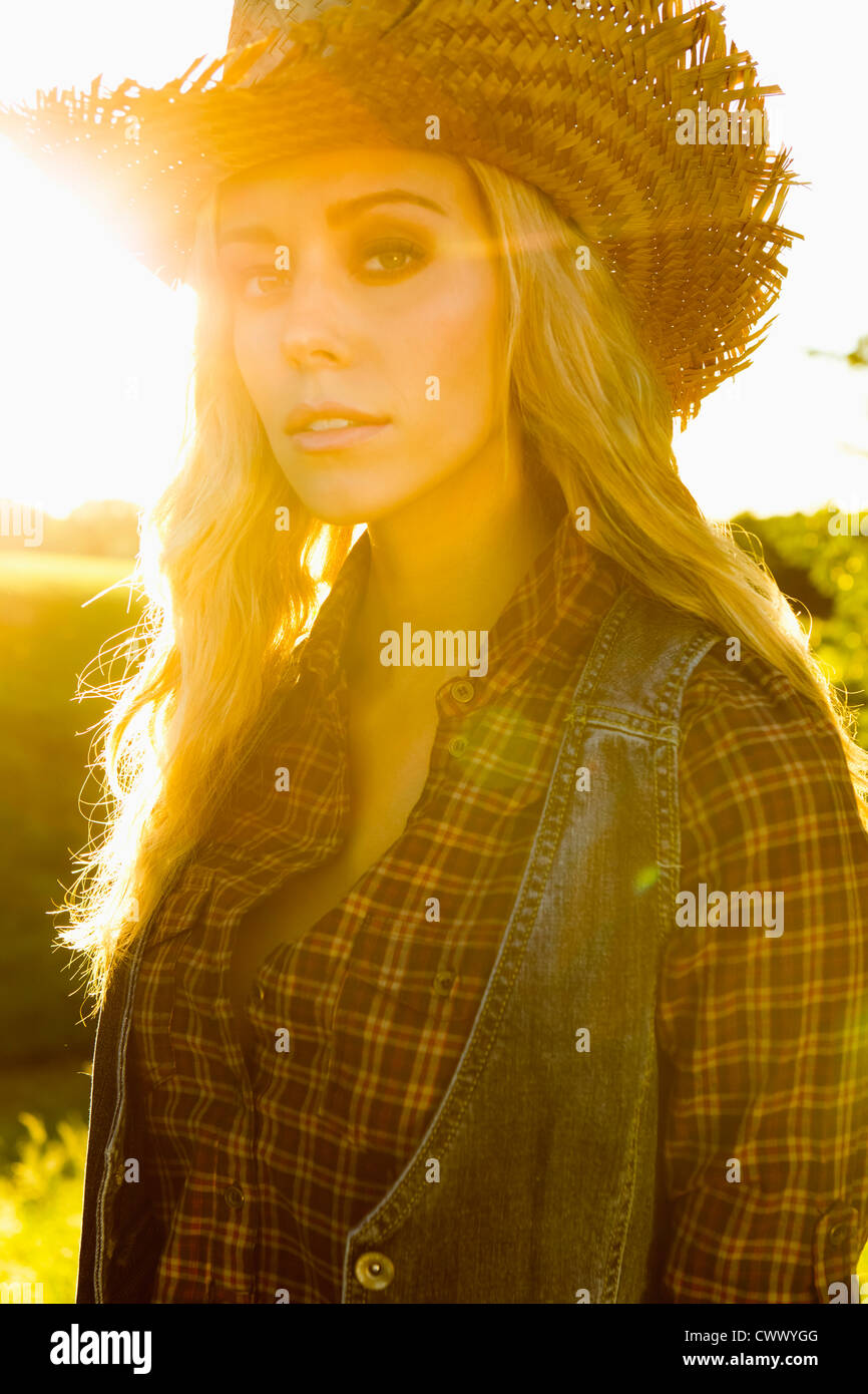 Woman wearing vest and straw hat Stock Photo