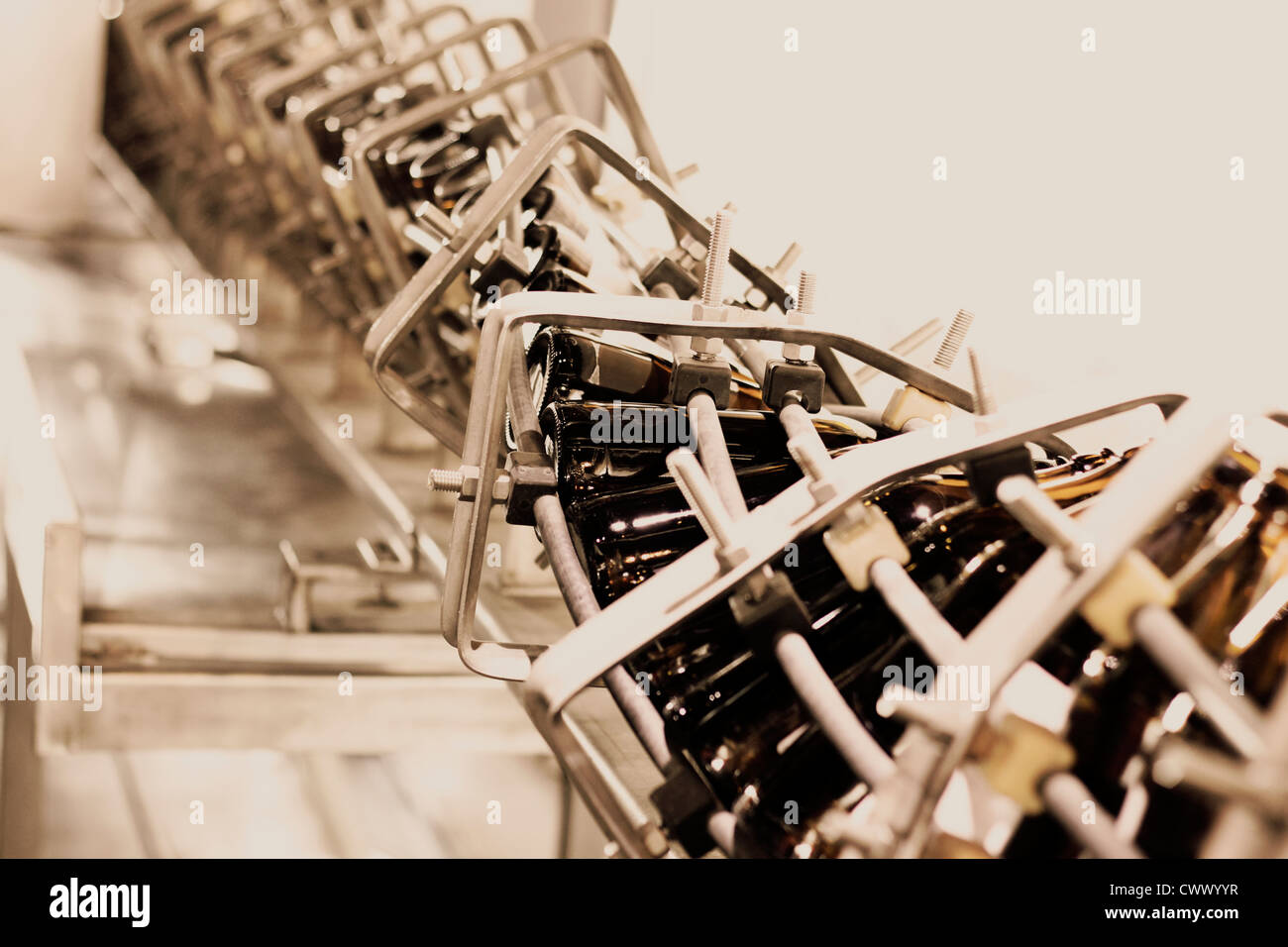 Old amber glass bottling line. - Stock Image