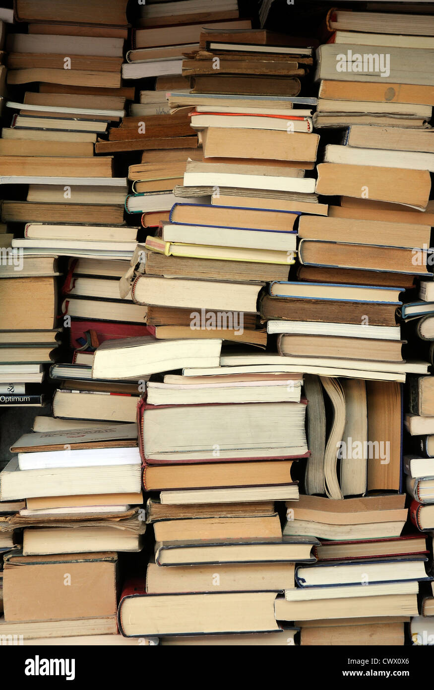 second hand piles of books stacked books second hand books stacked