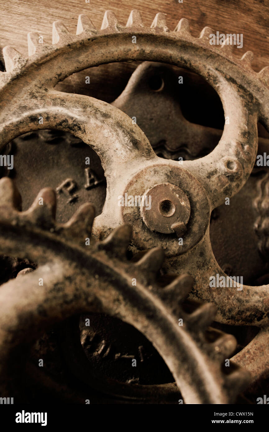 Gears of an old wooden hand crank wash board machine. - Stock Image