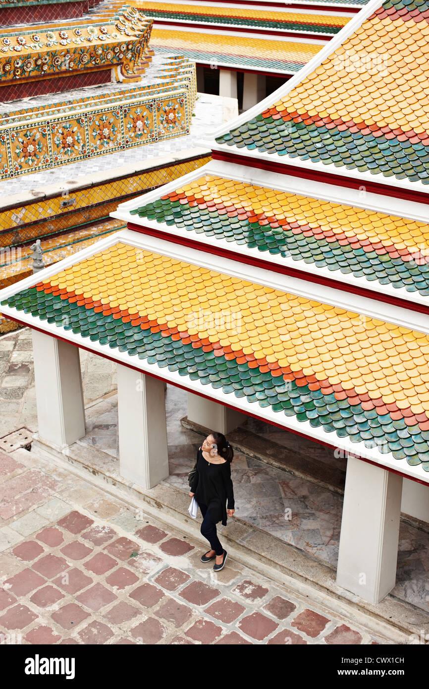 Woman exploring ornate temple - Stock Image