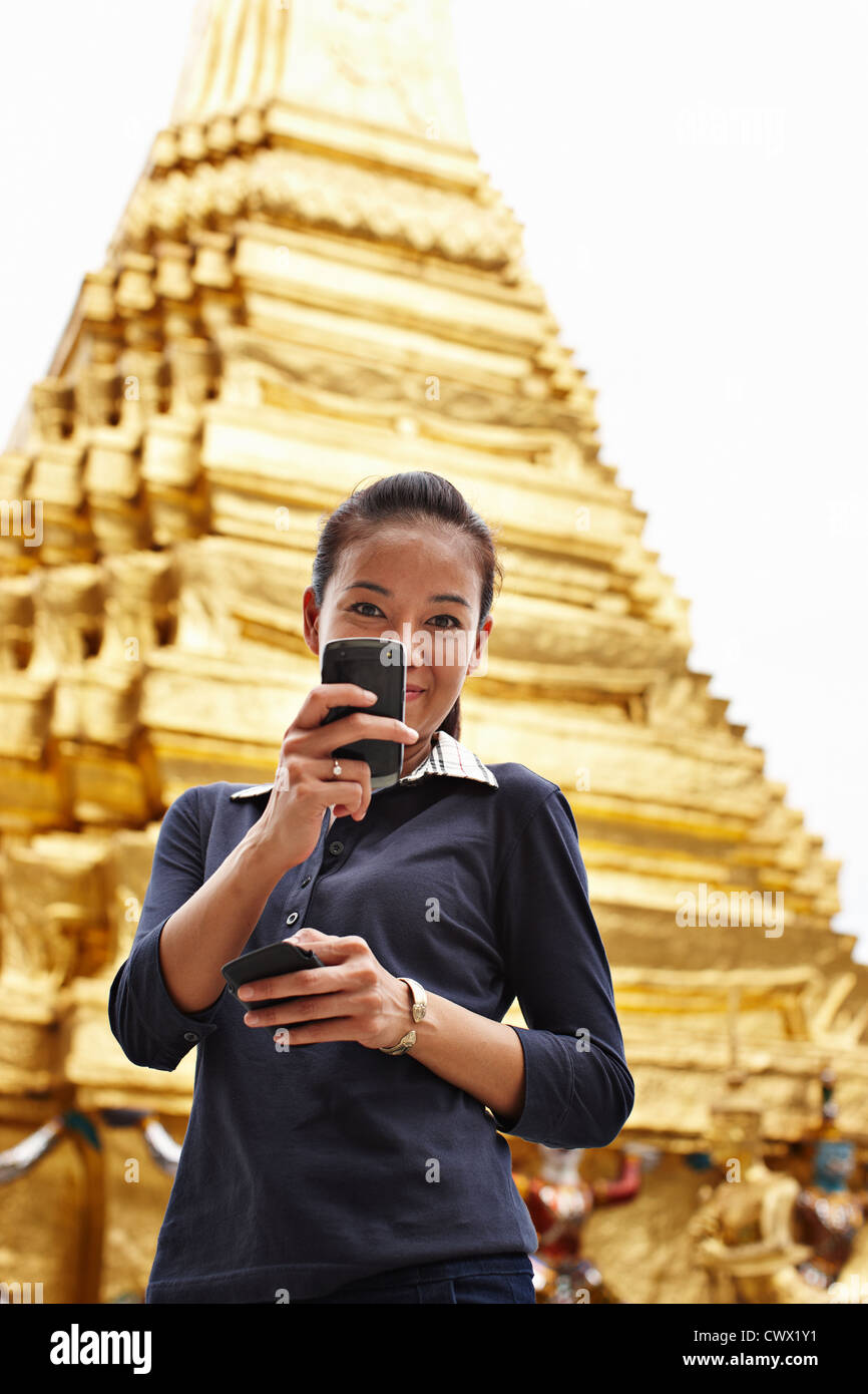 Woman taking picture with cell phone - Stock Image