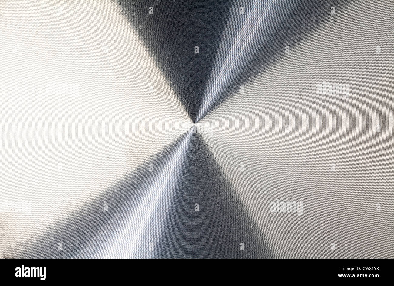 Reflections on a round aluminum plate - Stock Image