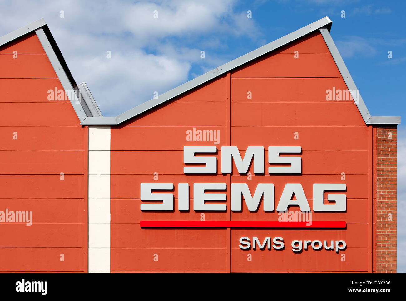 Corporate logo of the SMS Siemag AG on the factory building in Hilchenbach, North Rhine-Westphalia, Germany, Europe - Stock Image
