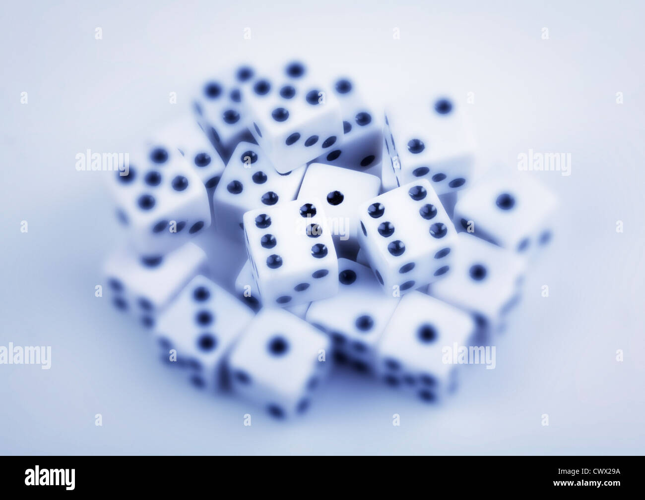 Dice, partly blurry, symbolic image for gambling - Stock Image