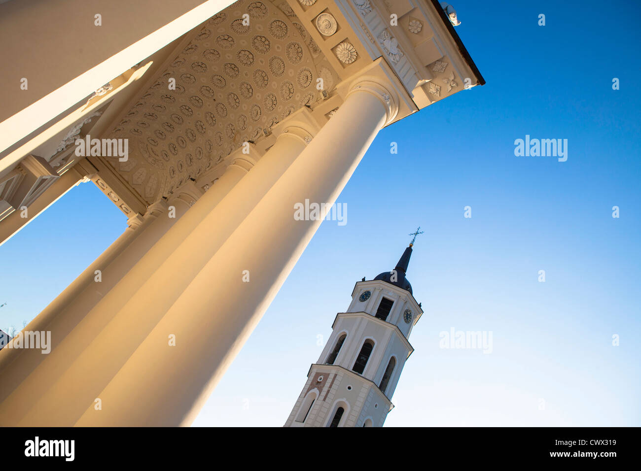 Pillars and tower against blue sky - Stock Image