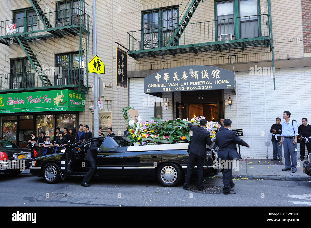 Hearse and flowers stock photos hearse and flowers stock images a funeral in manhattans chinatown with a hearse piled with flowers aug 31 izmirmasajfo
