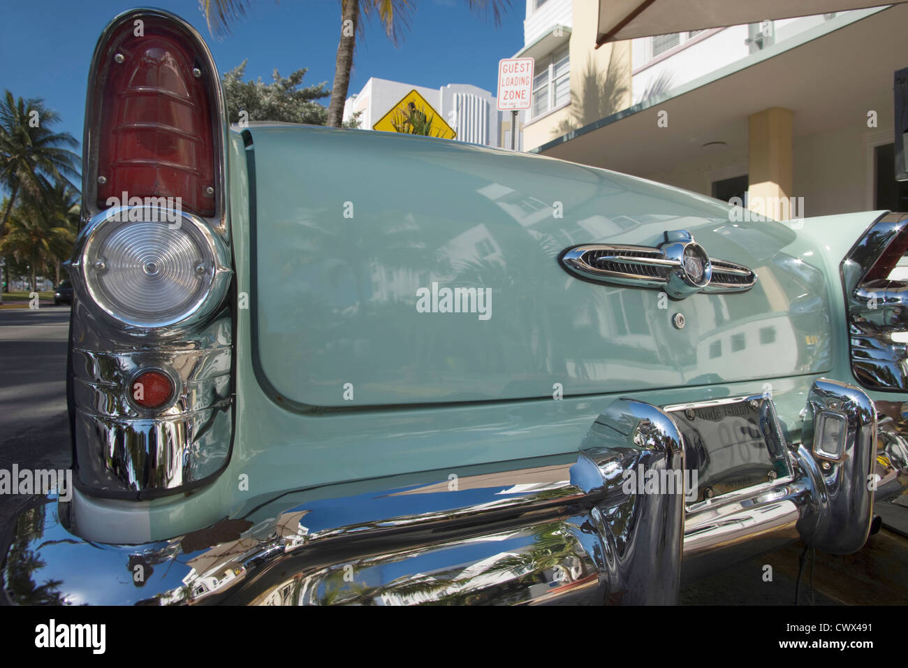 TAIL FIN OF CLASSIC 1950S TWO TONE BUICK CONVERTIBLE AVALON HOTEL OCEAN DRIVE SOUTH BEACH MIAMI BEACH FLORIDA USA - Stock Image