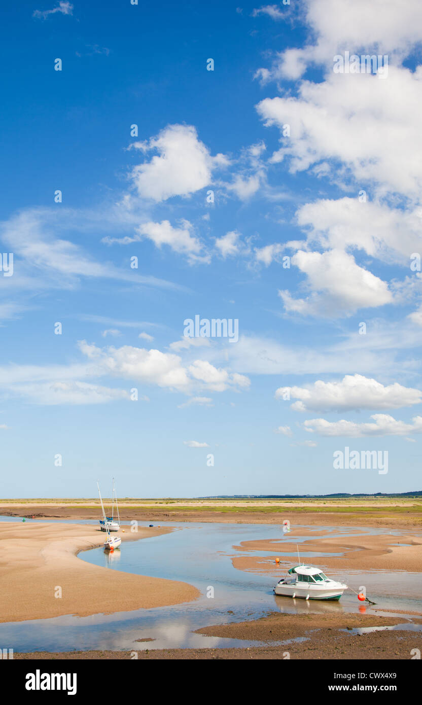 Wells-next-the-Sea, low tide, silted-up approaches to the harbor devoid of water Stock Photo