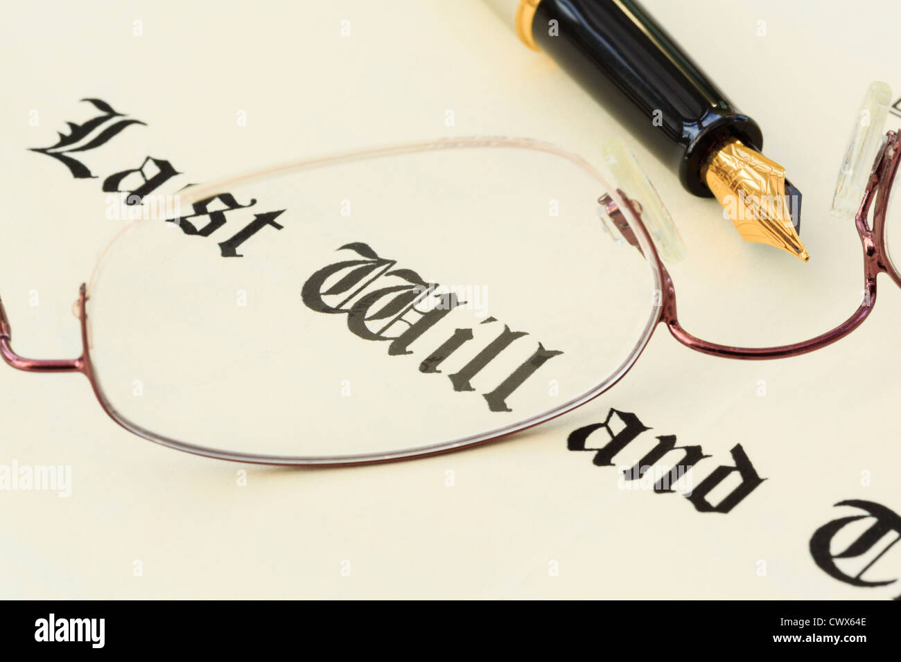 Last Will and Testament document with a pair of metal rimmed spectacles and a fountain pen for signing. England - Stock Image