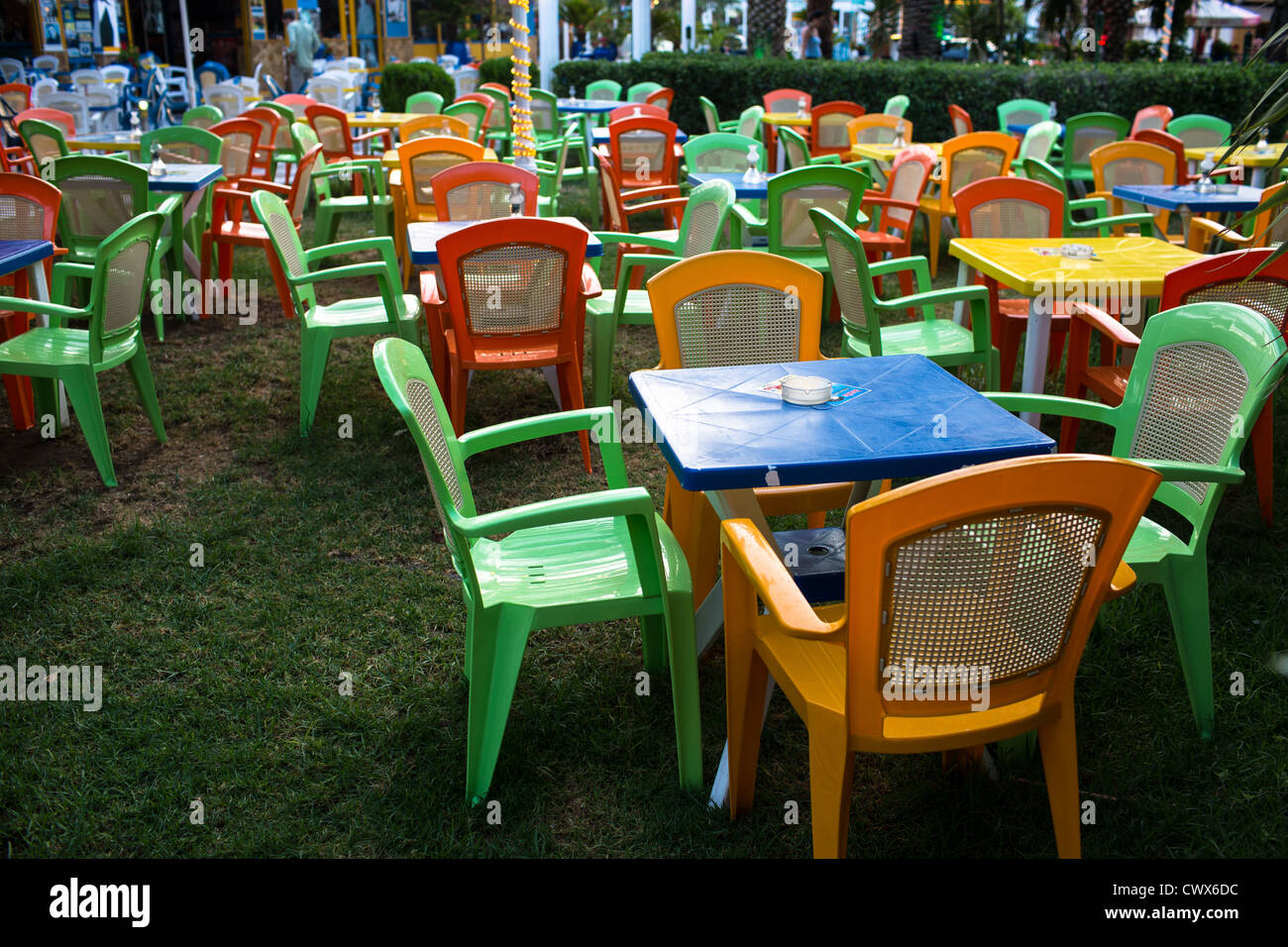 Empty plastic chairs in a beach cafe in Moraitika, Corfu, Ionian Islands, Greece. - Stock Image