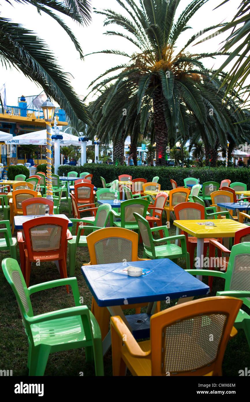 Empty plastic chairs in a beach café in Moraitika, Corfu, Ionian Islands, Greece. - Stock Image