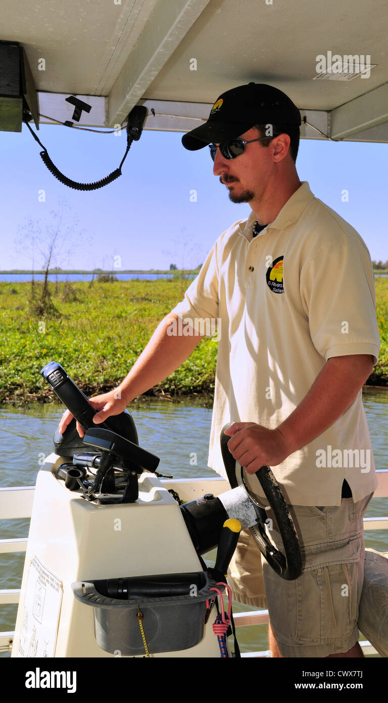 The captain guides the 'Pelican' during an ecologically oriented tour originating from the 5 Rivers Delta - Stock Image