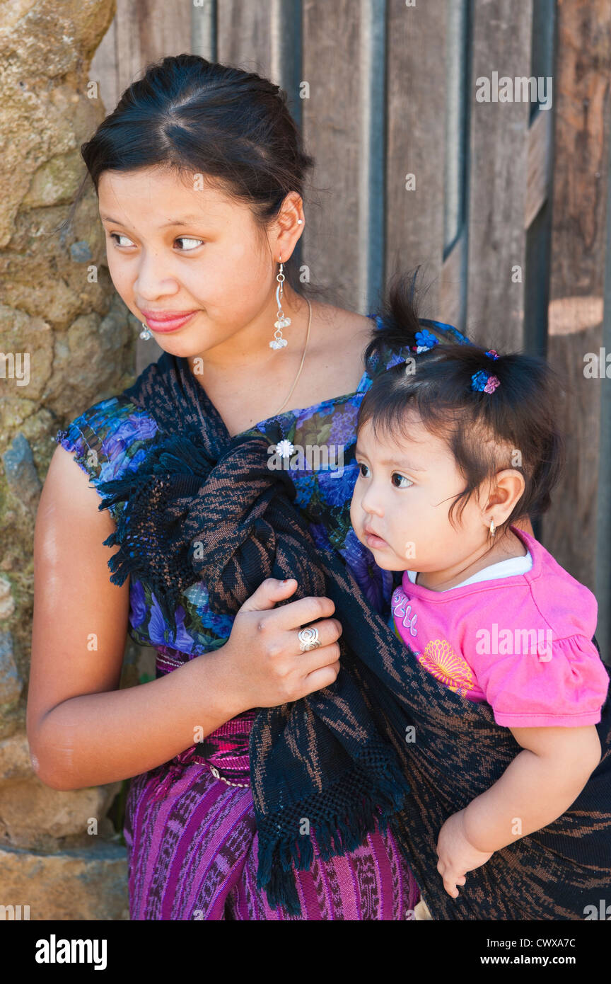 Mayan woman and child wearing traditional huipiles huipil blouse and corte skirt, Santiago Atitlan, lake lago atitlan - Stock Image