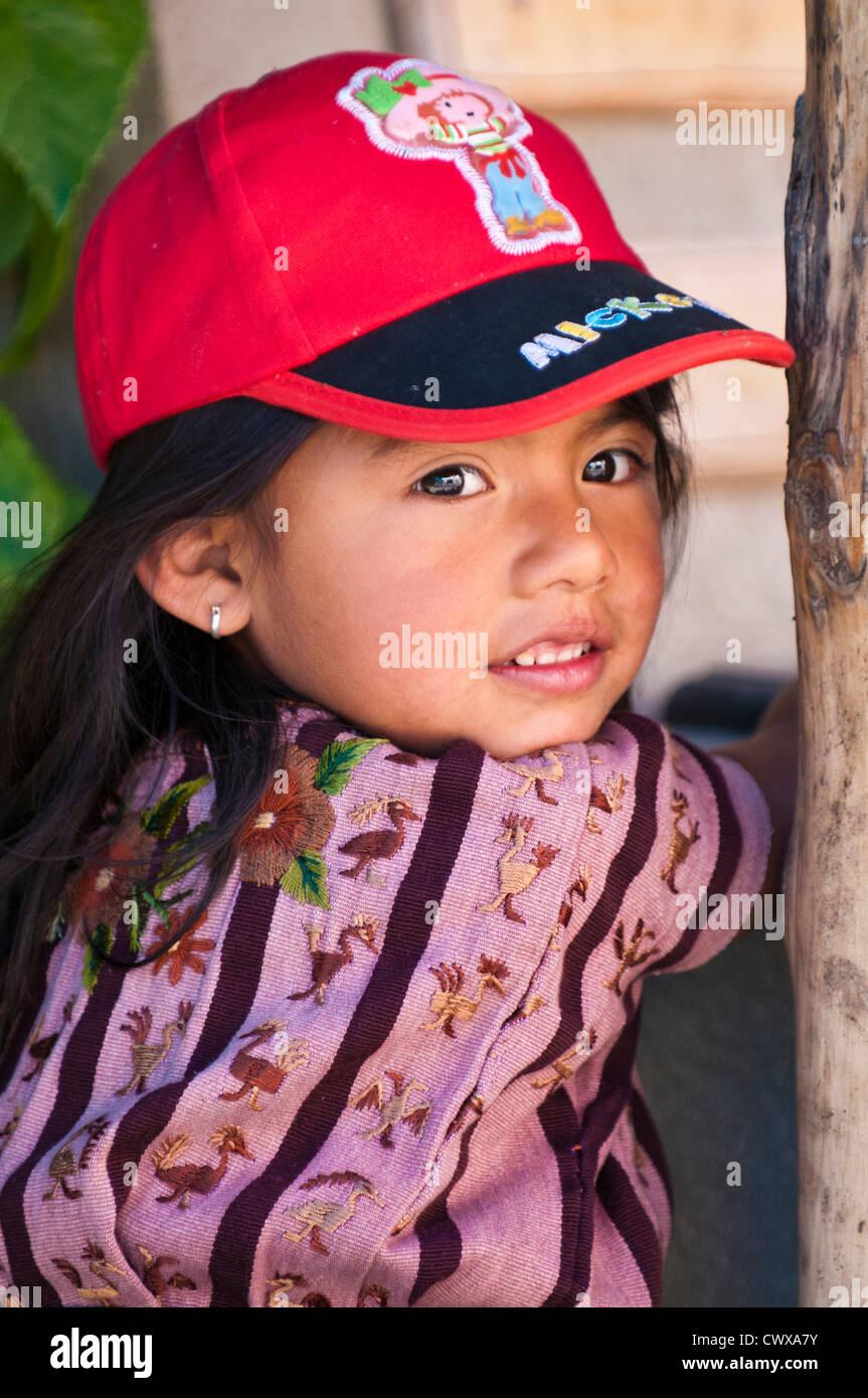 Guatemala, Santiago Atitlan. Young girl in red baseball cap smiling, santiago atitlan lago de atitlan lake atitlan - Stock Image