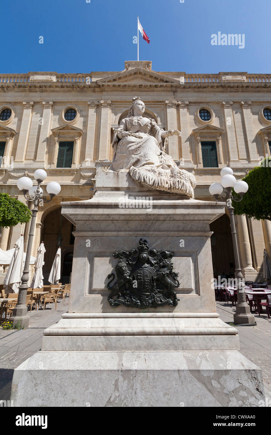 Statue of Queen Victoria outside National Library in Valletta capital city of Mediterranean island of Malta Europe - Stock Image