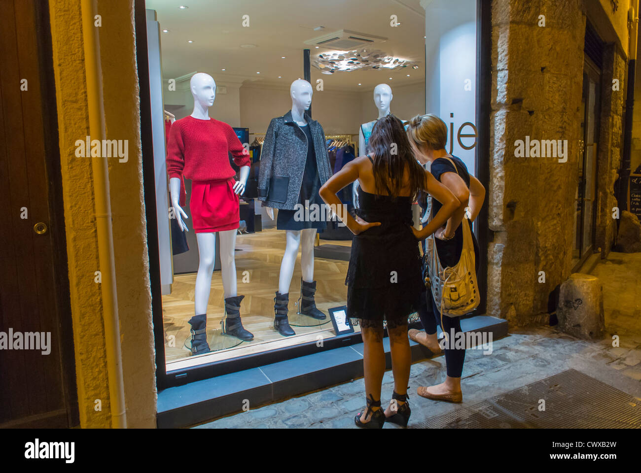 perpignan france women window shopping fashion stores in center
