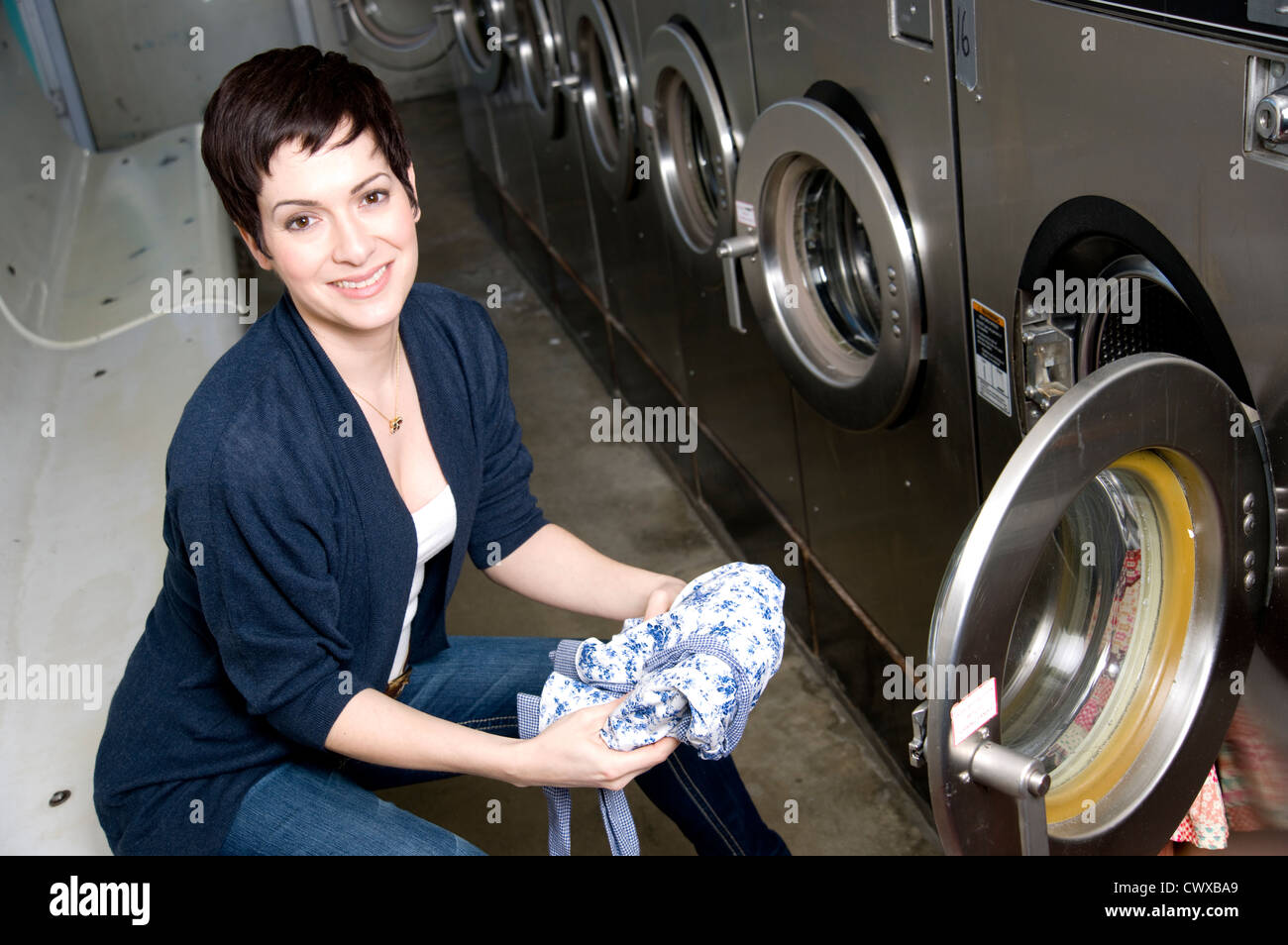 She does laundry with a smile - Stock Image