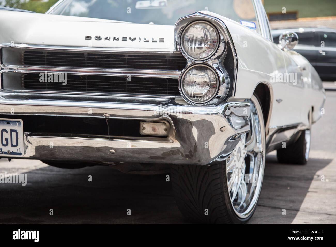 White classic convertible Pontiac Bonneville lowrider car on the street in Austin, Texas - Stock Image
