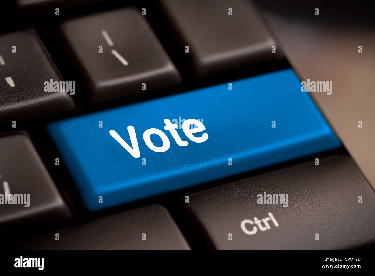 democracy concept with vote button on keyboard - Stock Image