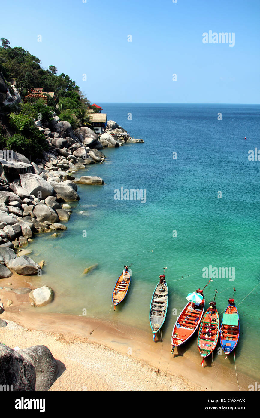 Traditional longtail boats at Andaman Sea in Thailand - Stock Image
