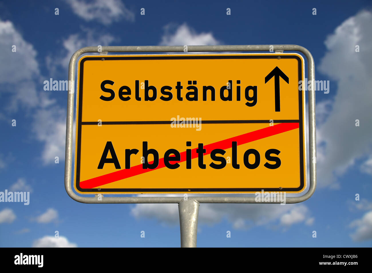 German road sign unemployed and self-employed with blue sky and white clouds - Stock Image