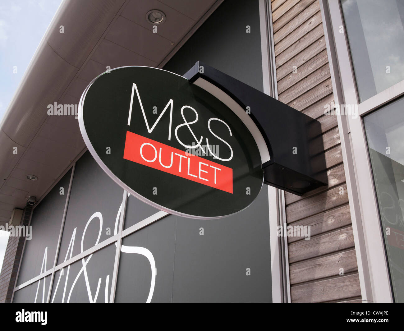 M&S sign at an retail outlet centre - Stock Image