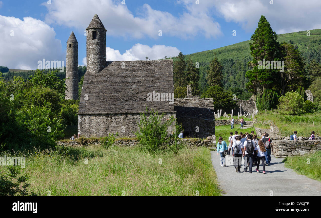 Tourists and school trip to St Kevin's Church and Round Tower at Glendalough, County Wicklow, Republic of Ireland - Stock Image