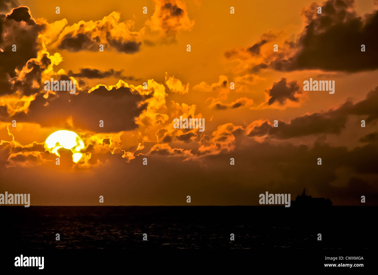 8101. Sunset over the sea stylised - Stock Image