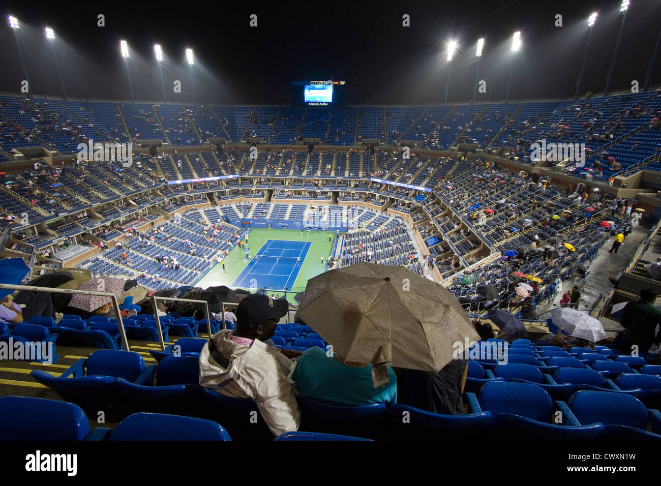 Arthur Ashe Stadium during a night session at the 2012 US Open tennis tournament. Taken during Andy Roddick's - Stock Image