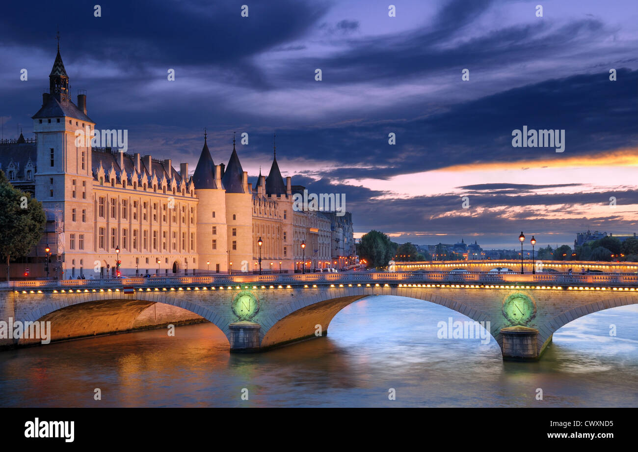 The Pont au Change, bridge over river Seine and the Conciergerieis, a former royal palace and prison in Paris, France. - Stock Image